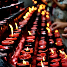 Lighting Candles by Leony Sibug - Artistic Objects Other Objects ( candle, red candles, candle lights, offering prayers and light a candle, lighting a candle, church candles )