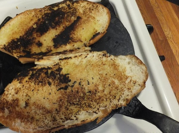 Brush Roasted Garlic Olive Oil on Buns and toast on a medium hot iron...