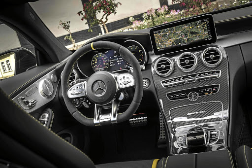 The interior gets the full AMG treatment but look closely and you will see a new dial on the steering wheel. Picture: DAIMLER