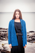 Photo: Merino Shawl Neck Cardigan -  Although this Shawl Neck Cardigan features the traditional Aran Cable design, echoing the Fisherman's ropes from long ago, its relaxed cardigan style and slim fit connect its roots with a much more modern era.  www.aransweatermarket.com/shawl-neck-cardigan-women