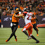 Your Going Down by Garry Dosa - Sports & Fitness American and Canadian football ( dancing, sports, teams, players, black, cfl, blur, football, people, professional, red, orange, number, white, indoors, stadium, event, jostling )
