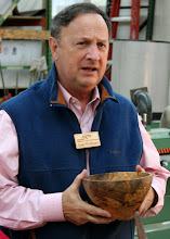 Photo: Stan Wellborn shows off the figure in his maple burl bowl.