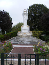 Photo: At the confluence (thus, the town's original name) of the Seine and Oise rivers is this war memorial to the bargers.