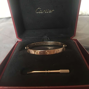 A cartier bracelet in its holder