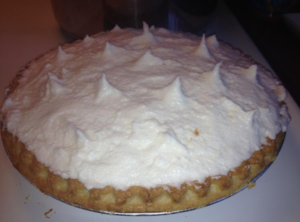 Spread meringue over hot filling and seal edges to crust