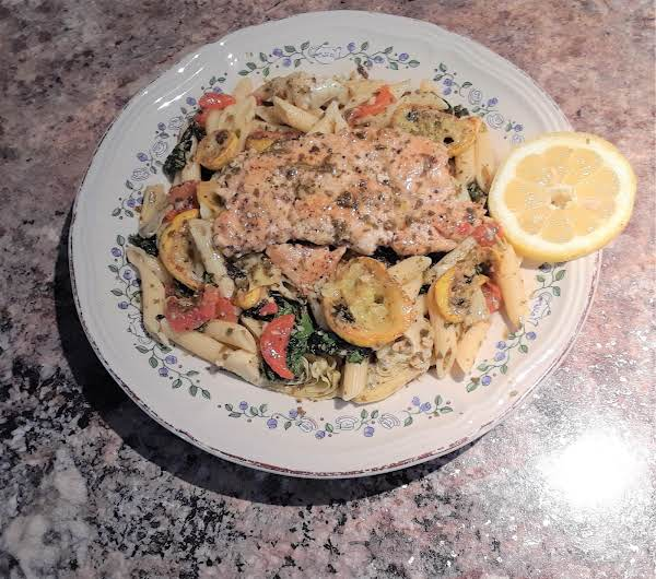 Lemon Basil Pesto Chicken Breast Over A Bed Of Penne Pasta, Artichoke Hearts, Posted Red Bell Peppers, Yellow Squash, Kale Greens.