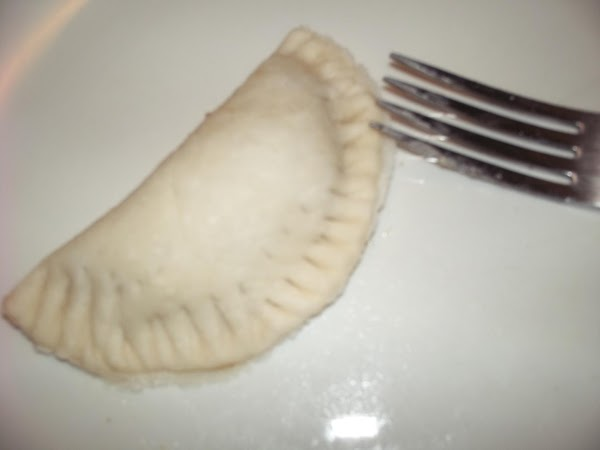 Fold over and press with your fingers to seal. Now use a fork and...