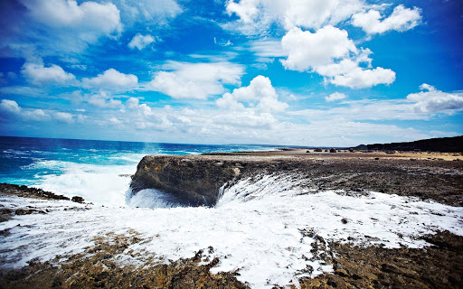 bonaire-wild-coastline2.jpg - Waves crash ashore along Bonaire's wild coastline.