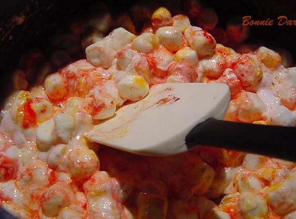 Melt the butter in a large saucepan over medium heat. Stir in marshmallows, carmel,...