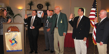 Photo: Cynde Covington, District Governor from Jacksonville installs Dennis Micare as President of the DeBary-Deltona Rotary Club for the 2010-2011 Rotary Year. Also in the picture is President Blaine Timmer who will be the Immediate Past President on July 1. Next to Blaine is our Vice President Bill Ottinger. Joe Alemany is our Secretary, and John Brim is the International Service Director. Other board members were unable to attend the banquet. - Held at the DeBary Golf and Country Club on June 5, 2010. (picture courtesy of Mark Van Fleet)