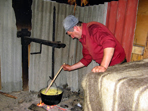 Photo: Inside the shepherd's hut, Marcel is making 'balmus' - a traditional type of polenta.