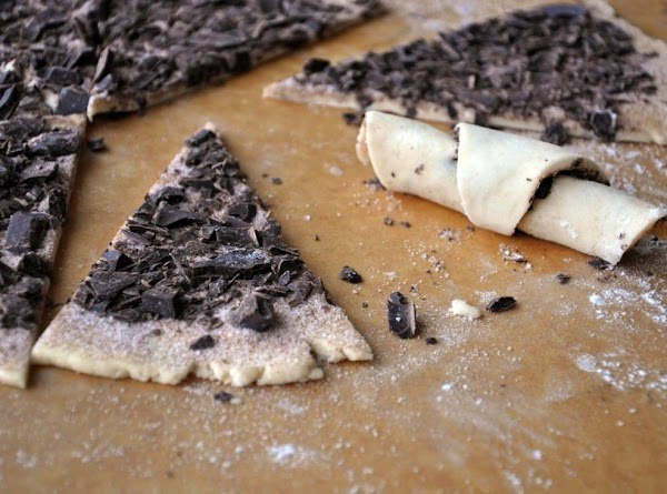 Sprinkle on the chocolate pieces or other filling,press slightly into dough.Cut into 8 or...