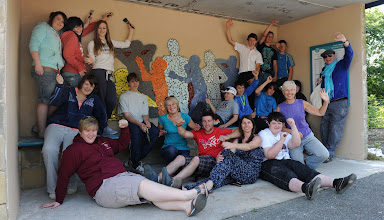 Photo: Young people from Ysgol Gyfun Tregib show off their new artwork at Llandeilo train station alongside Carmarthenshire youth worker, Karen Morris and Arts Care Gofal Celf artist, Teena Gould.