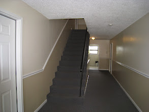 Photo: Typical common hallway with coin-op laundry room