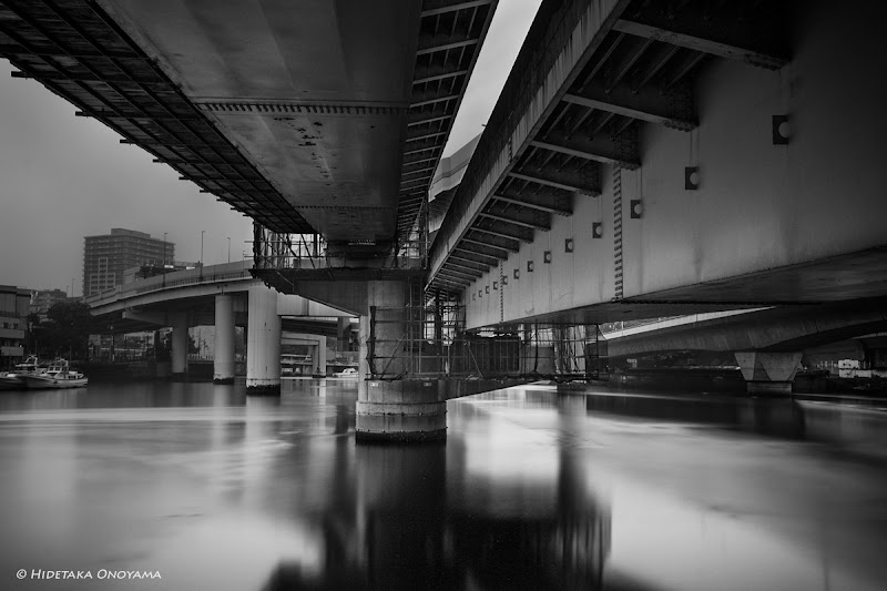 """Photo: Under the bridge (05/11/2013)  One of my favorite moments in the photowalk was organized by +Takahiro Yamamoto& +takashi kitajimain Yokohama, Japan last weekend. I'd like to """"Thank you"""" to them & other G+ friends joined the photowalk! I could simply enjoy the photo shootings. :-)  #Yokohama20130511 #GPlusPhotoWalkJapan   About gears: Sony A99, Vario-Sonnar T* 24-70mm ZA & Lee Big Stopper  #MonochromeMonday (+Monochrome Monday) curated by +Hans Berendsen +Jerry Johnson +Steve Barge +Dominique Hilbert , +David Orr +Martin Heller #LeadingLinesMonday curated by +Pam Boling +Andreas Levi +David Murphy +Elle Rogers +Michael B. Stuart +Simos Xenakis +BW DIGITAL PHOTOGRAPHY CLASSIC STYLE #swdpclcurated by +peter paul müller +peter paul müller #BridgesAroundTheWorld curated by+Carra Riley+Knut Arne Gjertsen  #A99 #Zeiss #BigStopper #Japan"""