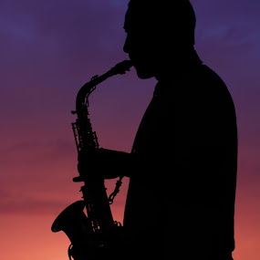 saxophone silhouette by Corine de Ruiter - People Musicians & Entertainers ( sky, sunset, saxophone, silhouette, man,  )