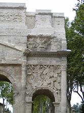 Photo: The arch is decorated with various reliefs of military themes, including naval battles (Augustus' victory over Anthony & Cleopatra), spoils of war, and Romans battling Gauls.