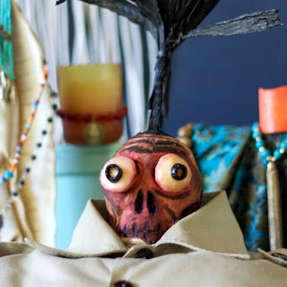 Beetlejuice Shrunken Head with Cheesy Eyeballs Recipe