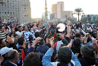 Photo: An impromptu drum circle in Tahrir Square with the Omar Makram mosque seen in the background.