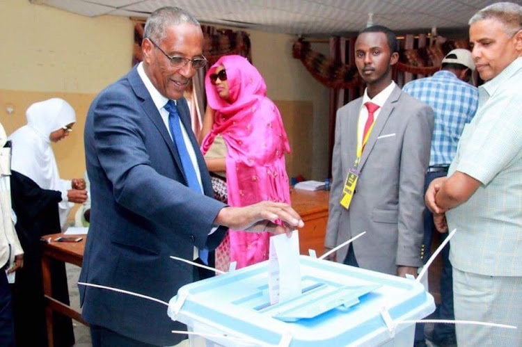 Muse Bihi Abdi, the candidate for the ruling Kulmiye Party, casts his vote in the November 2017 presidential election. He was elected as the fifth president of Somaliland with 55 per cent of the popular vote
