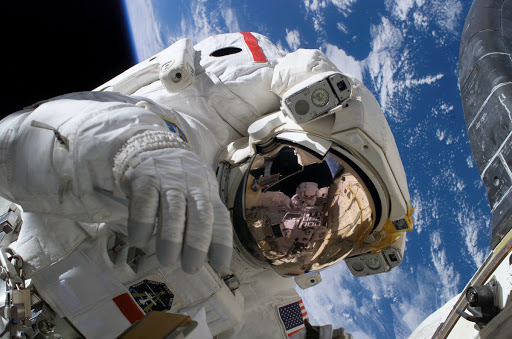 Mid-shot of Seller on EVA3 during STS-121 / Expedition 13 joint operations