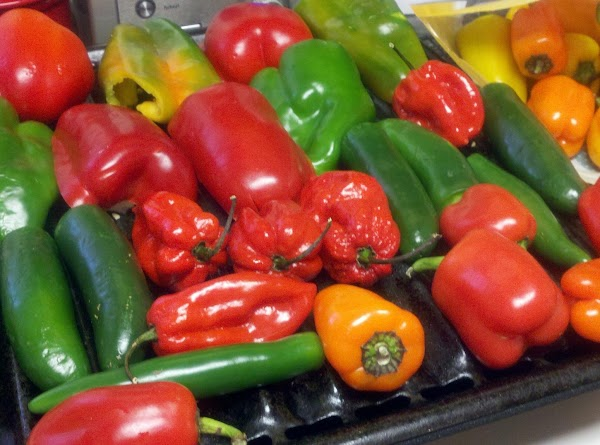 Start by spreading the peppers out on a foil-lined cookie sheet. Spray lightly with...