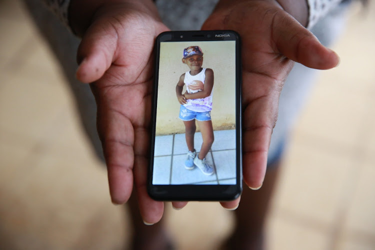 Mpho Makondo, 8, was the light of her family's life. She and neighbour Simphiwe Mncina, 6, were playing together when they were kidnapped and murdered.