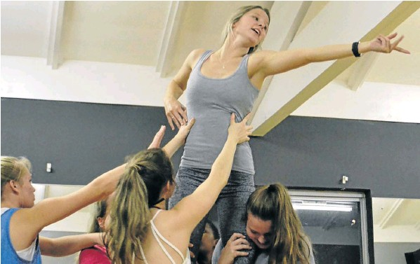 RELAYING MESSAGE: Dancer Kristen Kirtley is lifted up by fellow dancers during a rehearsal for 'The Last Straw'. Co-directed by local playwright Jen Bryson Moorcroft and dance teacher Charene Harris, the original musical theatre piece, promoting the reduced use of single use plastics, will be staged at the Alexander Playhouse from September 6- 8.