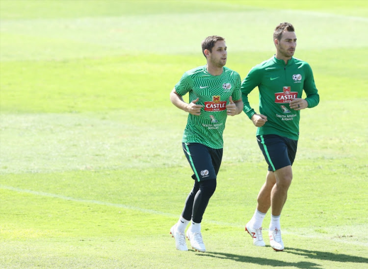 SuperSport United midfielder and captain Dean Furman (L) jogs with his club teammate striker Bradley Grobler ( R) during the Bafana Bafana training session at Princess Magogo Stadium in Durban on September 04, 2018.