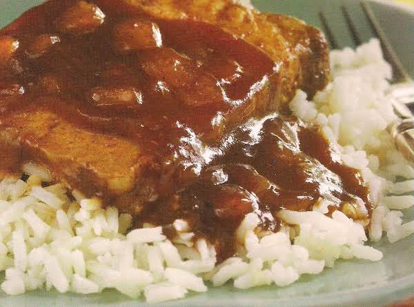 Smothered Pork Chops Over Rice