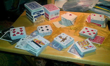 Photo: -- Progress so far: Cutting, trimming, and punching donated playing cards for #cardweaving  (February 16, 2012)