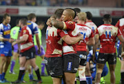 Elton Jantjies of the Lions and team mates celebrate during the Super Rugby match.