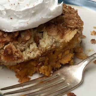 Pumpkin Pie Crunch Cake with Cinnamon Sugar Whipped Cream.