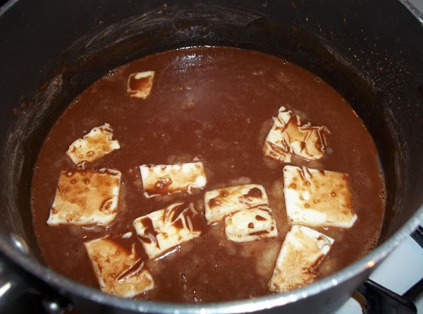 In a large saucepan, combine the cocoa and water until smooth; add butter. Bring...