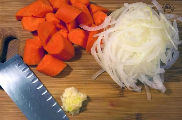 Thinly slice the onion, mince the garlic, and cut the carrots thickly on the...