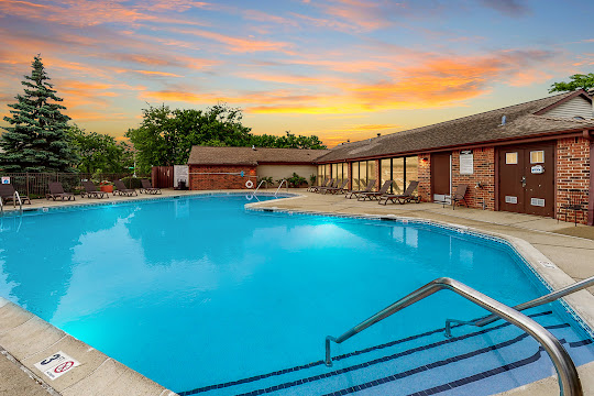 Remington Place apartment swimming pool outside of clubhouse at dusk