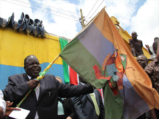 Homa Bay Governor Cyprian Awiti during the launch of Gendia Kadongo road on March 25 2014.Pix Habil Onyango