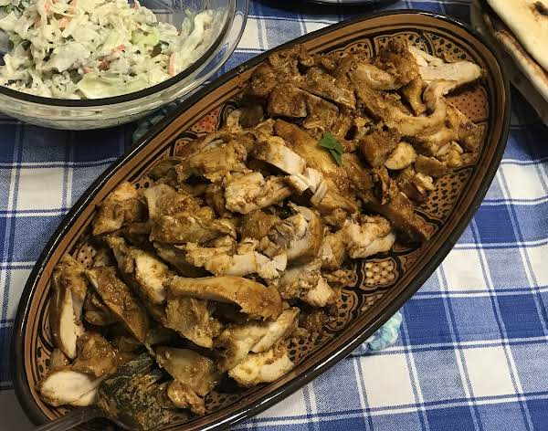 Platter Of Chicken Shwarma On A Table.