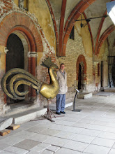 Photo: Cathedral courtyard.  Not sure what the big chicken is all about