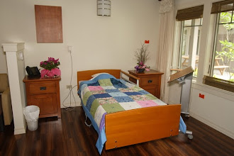 Photo: One of 12 patient rooms. Each has a beautiful bed, extra sleeping space for visiting loved ones, individually controlled air, private lanai and bathroom with accessible shower.
