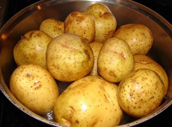 Wash potatoes. Place in large pot cover with water.  Bring to a boil,...