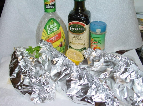 Bring two sides of the foil up and fold over several times to seal...