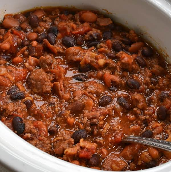 Crock Pot Cowboy Beans Are A Family Friendly Slow Cooked Recipe Of Browned Ground Beef, Ham, Crispy Bacon, Pinto Beans, Black Beans And Onions All In A Sweet Tomato Based Sauce.