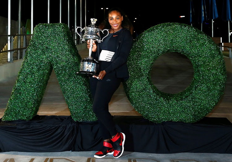 Serena Williams of the U.S. poses with the Australian Open Women's singles trophy after winning her final match.