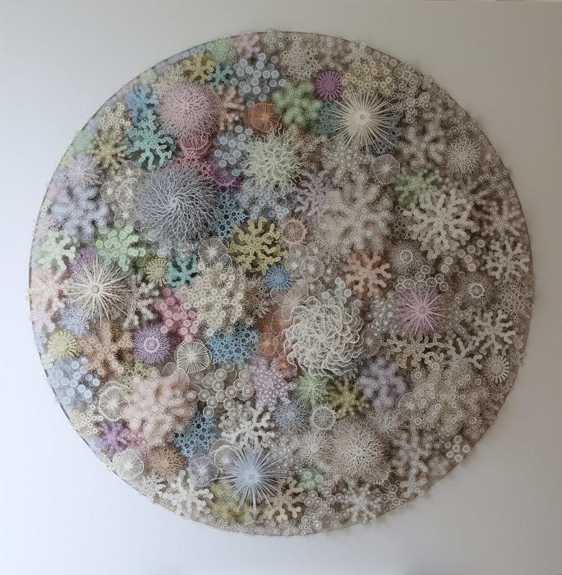 El microbioma humano reinventado como un arrecife de coral de papel cortado