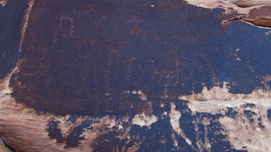 Photo: Heavily patinated petroglyphs