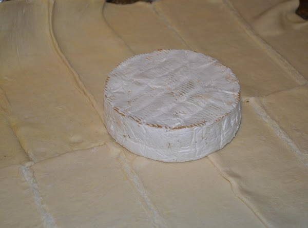 unwrap the brie and place in the center of the four corners of the...