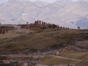 Photo: The Inti Raymi procession arrives over the ill at Sacsaywamen ..