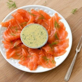 Homemade Gravlax (salted salmon) with dill sauce and mustard.