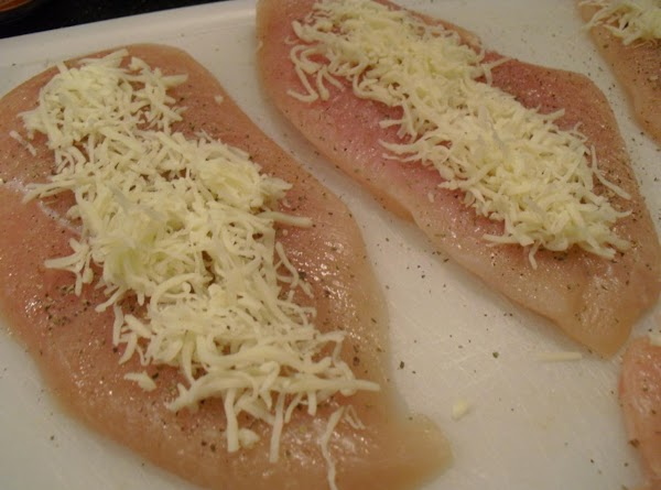 Place a small amount of the cheese over the chicken breasts.